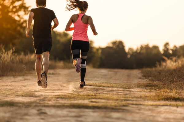 young-couple-running-forest-trail